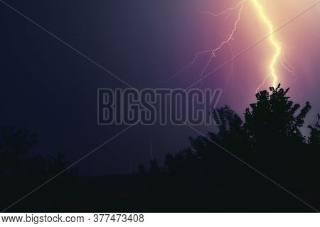 Thunderbolt In The Night. Thunder Strike Lightnings During A Raging Storm In A Wild Nature