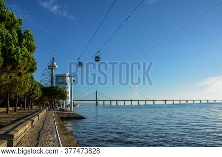 Telecabines (cable Cars) At Park Of Nations (parque Das Nacoes) And Vasco Da Gama Bridge Over The Ta