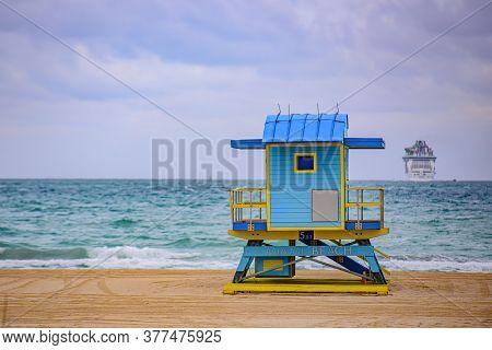 Panorama Of Miami Beach, Florida. Miami South Beach Lifeguard Tower And Coastline With Cloud And Blu