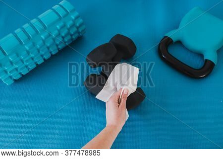 The New Normal After Covid-19, Hand Cleaning Gym Equipment With Disinfectant Wipe Against Virus And