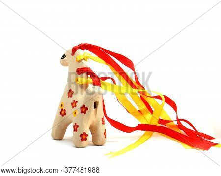 Ceramic Whistle Horse With A Mane Of Yellow And Red Ribbons And Painted With Flowers Isolated On A W