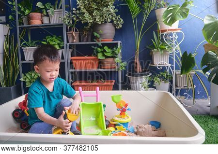 Cute Asian 3 - 4 Years Old Toddler Boy Playing With Sand Alone At Home, Child Playing With Toy Const