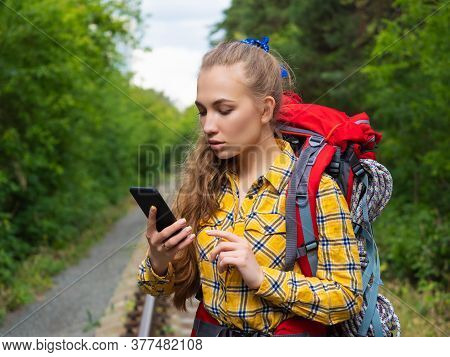 Hiker Woman Lost In Forest. She Using Mobile Gps Map. Close-up Portrait.