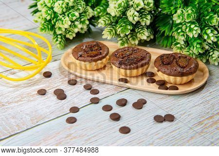 Chocolate Tart Brownies With Raisins On Wooden Dish - Stock Photo