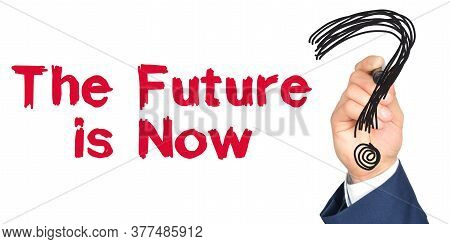 Hand With Marker Writing: The Future Is Now. Hand Of A Businessman With A Marker.