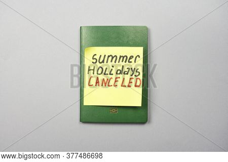 A Passport And Sticker With Words - Summer Holidays Cancelled. Effect Of Covid-19 And Coronavirus On