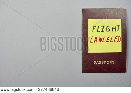 A Passport And Sticker With Words - Flight Cancelled. Covid-19 And Coronavirus Problems. Flight Canc