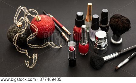 Make-up Products And Xmas Decoration Against Black Background, Copy Space