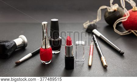 Make-up Accessories And Xmas Decoration Against Black Background, Copy Space