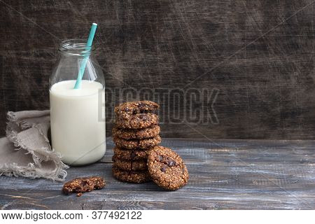 Healthy Gluten-free Buckwheat Cookies With Chocolate And Bottle Of Milk On A Wooden Table, Space