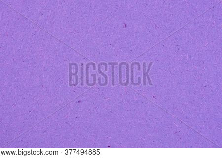 The Surface Of Dark Violet Cardboard. Paper Texture With Cellulose Fibers. Saturated Color. Purple B