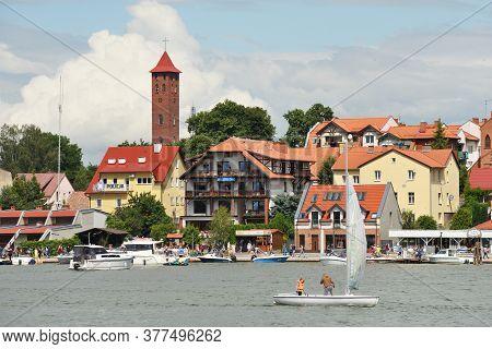 Mikolajki, Poland, July 12: View To City From The Lake On July 12, 2020 At Mikolajki, Poland. Mikola