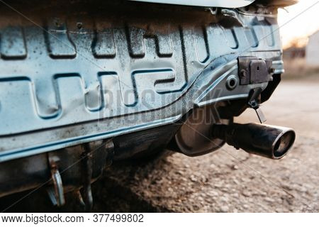 A Car Without A Bumper, The Exhaust Pipe Is Visible. Repair Is Needed. Close-up. Car Insurance Conce