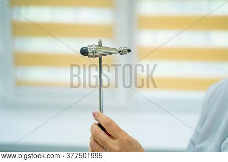 Reflex Hummer Isolated In Doctors Hands. Medic Holds Reflex Hummer To Camera.