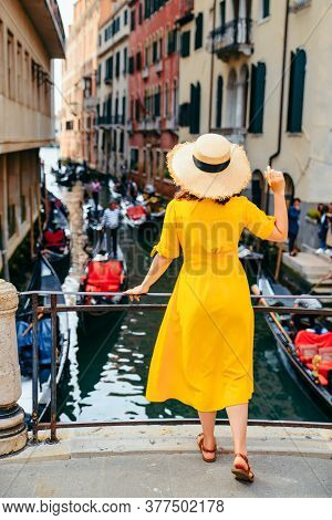Woman In Yellow Sundress At Bridge With View At Venice Canal
