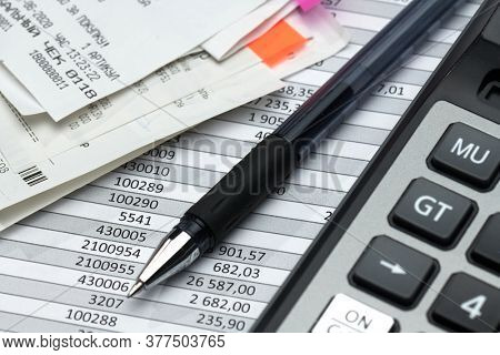 cash registers purchase receipt written on russian language, calculator and financial reports, analysis and accounting, various office items for bookkeeping