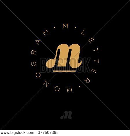 M Monogram Into Circle. M Logo. Gold M Monogram, Isolated On Black Background. Logo Can Be Used For