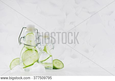 Joy Bright Fresh Summer Drinks With Green Cucumber, Ice Cubes, Soda Water In Two Elegant Yoke Bottle