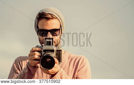 Photojournalist Concept. Travel Blogger. Professional Photographer. Handsome Photographer Guy Retro