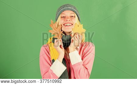 Autumn Skincare Tips. Skincare And Beauty Tips. Woman Cute Face Wear Knitted Hat Hold Fallen Leaves.