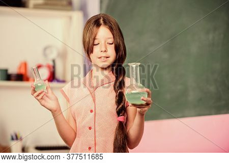 Fascinating Lesson. Chemical Reaction. Chemical Liquid. Science Lesson. School Laboratory. Small Gir