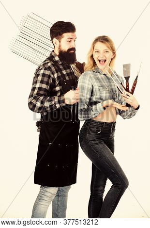 Cooking Together. Tools For Roasting Meat Outdoors. Picnic And Barbecue. Bearded Hipster And Girl Re