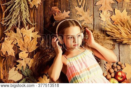Enjoy Music And Relax. Enjoy Perfect Sound. Girl Lay Fallen Leaves Wooden Background. Music Applicat