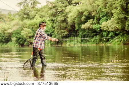 Activity And Hobby. Fishing Freshwater Lake Pond River. Happiness Is Rod In Your Hand. Senior Man Ca