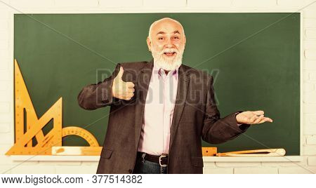 Feel The Success. Trigonometry Lesson In Classroom. Get Knowledge Here. Senior Man Teacher Use Math