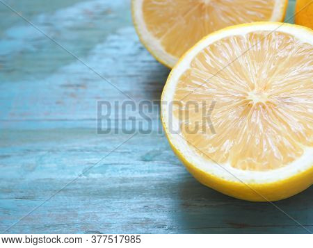 Close Up Half Lemon On Blue Background With Copy Space. High Vitamin C, Which Helps Control Weight A