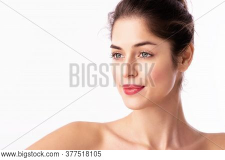 Beautiful Woman Wearing Red Lipstick While Standing At Isolated White Background