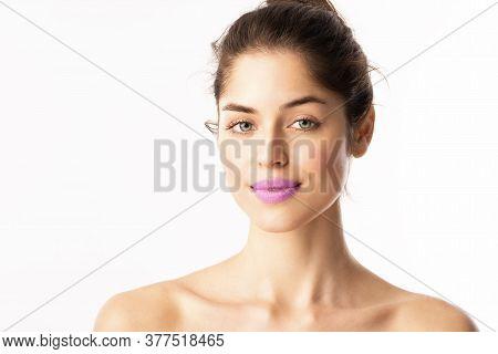 Headshot Of Beautiful Woman Wearing Purple Lipstic While Posing At Isolated White Background