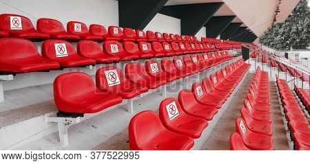 Seat For Sport Audience, Spectator With Sign Do Not Sit To For Space On Each Chair At Football Sport