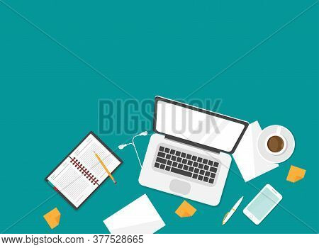 Workplace With Coffee, Smartphone, Pen And Laptop. Workplace Isolated On Blue Background. Notebook T
