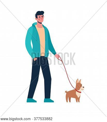 Man Walking With Little Dog. A Male In Casual Clothes Holding A Puppy On A Leash. An Active Walk In