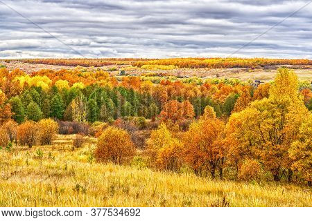 Picturesque Autumn Landscape In Green And Yellow Colors. Panoramic View From Hill To Lowland With Gr