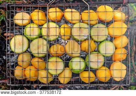 Pieces Of Squashes And Potatoes Roasted On Grille Over Charcoal