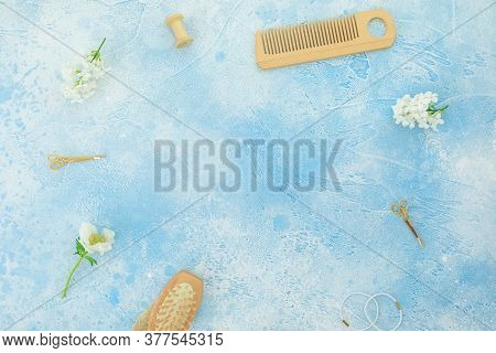 Hair Dresser Copy Space Composition With Hairbrush, Tassel And White Flowers On Blue Background. Fla