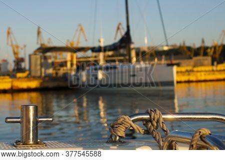 Mooring Of The Ship In Odessa. Mooring Bollard And Mooring Rope.