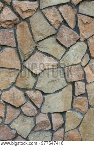 Limestone Texture. Wallpaper For Building Themes. Background With Rough Stone Surface. Vertical Phot