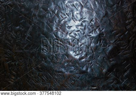 Texture Of Metal With Dents From Bumps Close Up