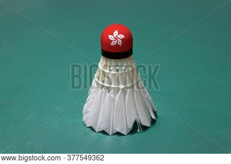 Used Shuttlecock And On Head Painted With Hong Kong Flag Put Vertical On Green Floor Of Badminton Co