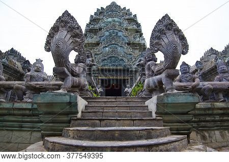 Khmer Culture On Koh Phangan Island In Thailand, Statues Of Ancient Gods And Many Headed Serpents, O
