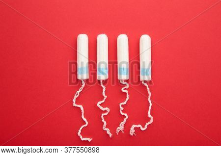 Menstrual Tampon On A Red Background. Cotton Tampon For Women. Top View