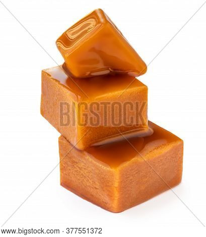 Caramelized Caramel Toffee Candy Isolated On White Background. Homemade Caramel Pieces With Sauce