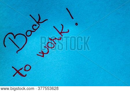 Back To Work Handwriting Text Close Up Isolated On Blue Paper With Copy Space. Writing Text On Memo