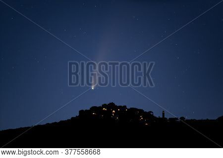 The Neowise C/2020 F3 Comet Passes Over The Ancient Mountain Village Of Sant'antonino In Corsica