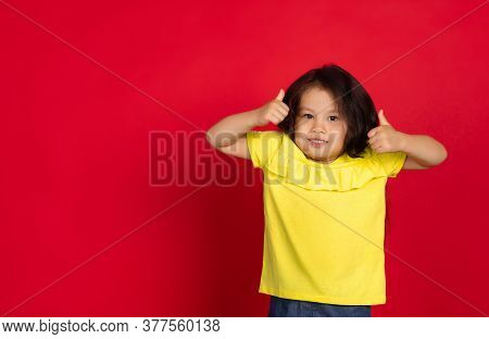 Nice, Thumbs Up. Beautiful Little Girl Isolated On Red Background. Half-lenght Portrait Of Happy Chi