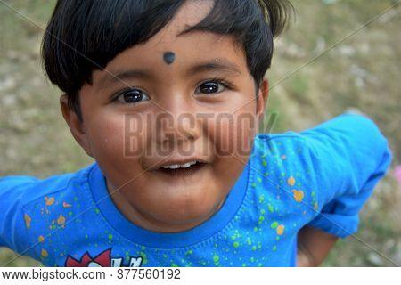 Morighata, Bongaon, West Bengal, India, 17 January, 2020: Close Up Of A Small Boy Teasing On Camera.