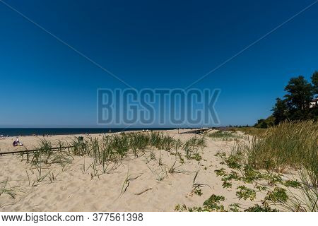 Village Yantarny, Kaliningrad Region - July 2020: Sandy Beach On The Baltic Sea Coast At The Height